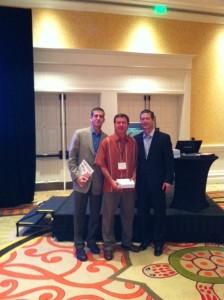 Euby accepts the award on the behalf of Suncoast Marketing